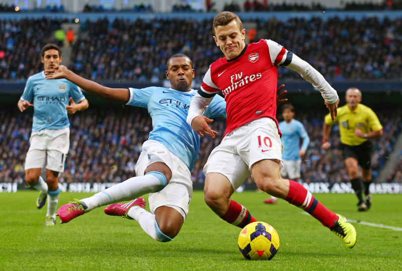 """Football - Manchester City v Arsenal - Barclays Premier League - Etihad Stadium - 14/12/13 Manchester City's Fernandinho (L) in action with Arsenal's Jack Wilshere Mandatory Credit: Action Images / Jason Cairnduff Livepic EDITORIAL USE ONLY. No use with unauthorized audio, video, data, fixture lists, club/league logos or """"live"""" services. Online in-match use limited to 45 images, no video emulation. No use in betting, games or single club/league/player publications. Please contact your account representative for further details."""