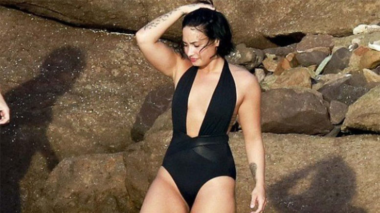 Singer Demi Lovato has released a photo of the suit and said that he doesn't have a complex with the aesthetics of the body (Photo: Instagram/Playback)
