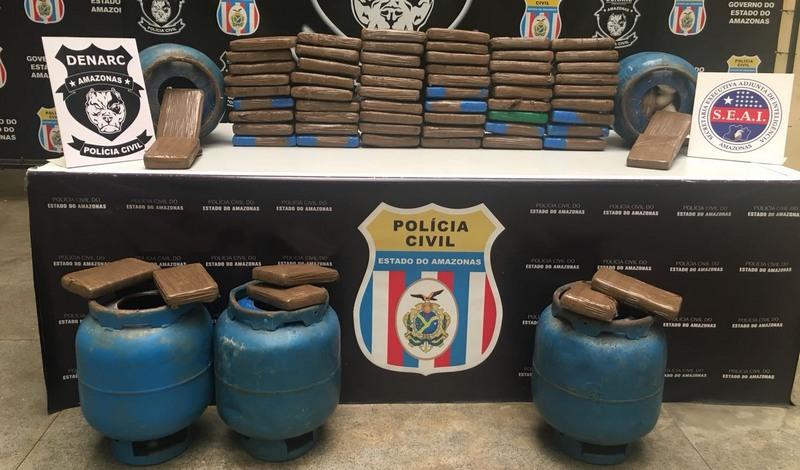 Cocaína era guardada dentro de botijas de gás em casa em condomínio de luxo em Manaus (Foto: SSP-AM/Divulgação)