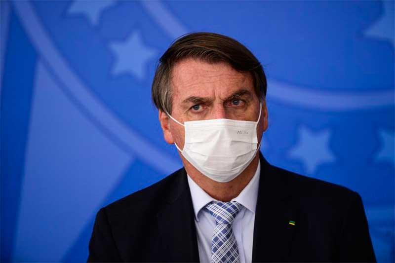 Presidente Jair Bolsonaro adota máscara e discurso pró vacina (Foto: Marcelo Camargo/ABr)